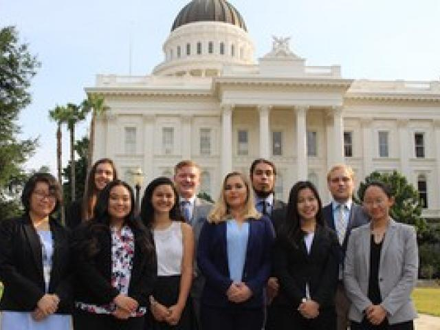 group of business students standing outside capitol building, sacramento